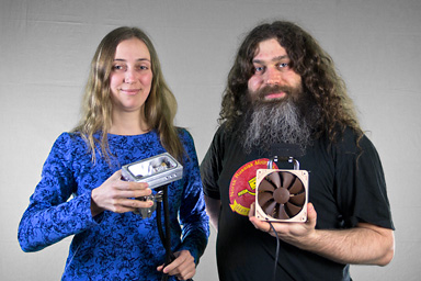 Elena Anisimova and Vadim Makarov, holding new and old models of photon detectors